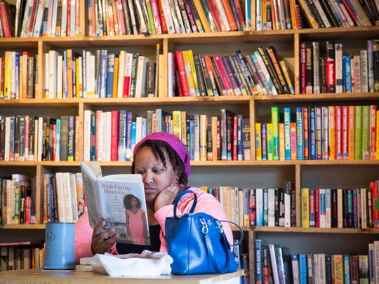 Patrons read books while enjoying beer and food at