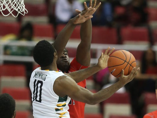 Jaleel Hogan defends against the Wright State Radiers Biggie Minnis ...