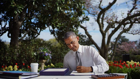 President Obama signs the Medicare bill.