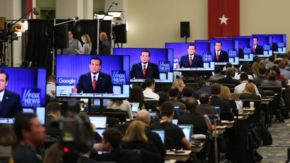 Ted Cruz is seen on television screens as reporters