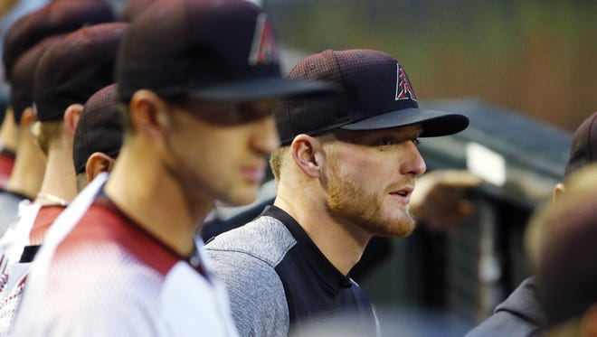 Diamondbacks pitcher Shelby Miller watches Monday's game from the dugout.