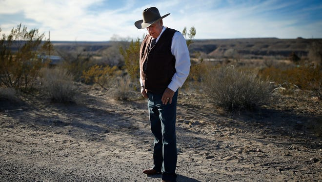 FILE - In this Jan. 27, 2016, file photo, rancher Cliven Bundy stands along the road near his ranch in Bunkerville, Nev. The Nevada rancher freed from federal custody this week after his prosecution on conspiracy and assault on government officer charges collapsed is casting himself as having fought the law and winning. (AP Photo/John Locher, File)