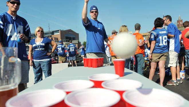 Colts fans play beer pong while tailgating before a game.
