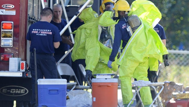 Montgomery fire and police work a HAZMAT situation in removing a women believed at the time to have Ebola symptoms from Benkwith Eye Center on Zelda Road in Montgomery on Oct. 17.
