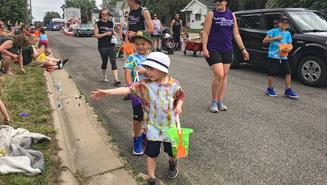 Kids hand out candy  in the Waite Park Family Fun Fest parade on Saturday, June 10.