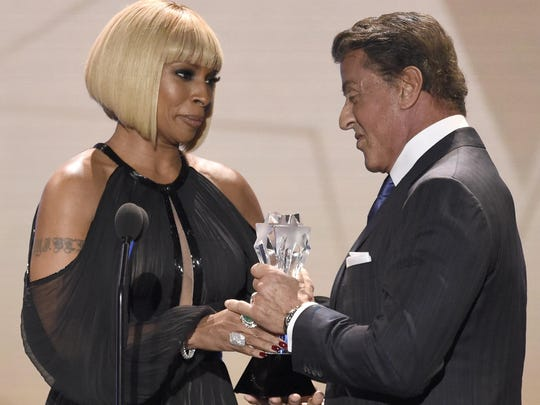 "Mary J. Blige, left, presents Sylvester Stallone with the award for best supporting actor for ""Creed"" at the 21st annual Critics' Choice Awards."