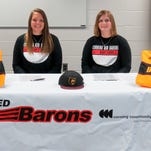 Corning Community College's Gabby Citriniti, left, and Jamie Cook signed Friday to play softball at Division II Bloomfield College in Bloomfield, N.J.