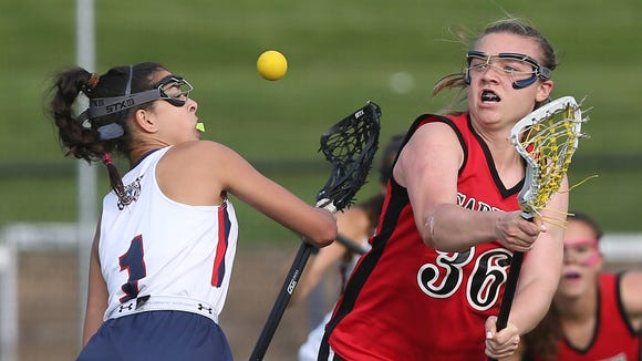 From right, Rye's Margaret Mitchell (36) and Byram Hills's Lilly Ceisler (1) battle for a face-off  during girls lacrosse action at Byram Hills High School in Armonk May 10, 2018. Rye won the game 13-12.