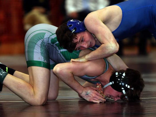 South Plainfield's Anthony White (left) wrestles Westfield's