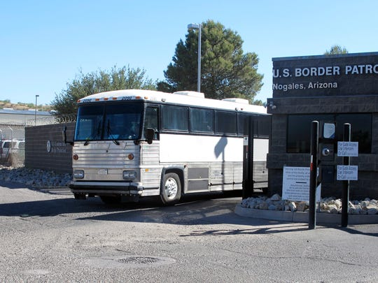 A bus leaves the entrance of the U. S. Border Patrol facility on Saturday, June 7, 2014 in Nogales, Ariz.