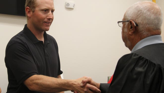 Chance Parsons is sworn in at the newest member of the Loving Municipal School board Tuesday at the board's regular meeting in Loving, New Mexico.