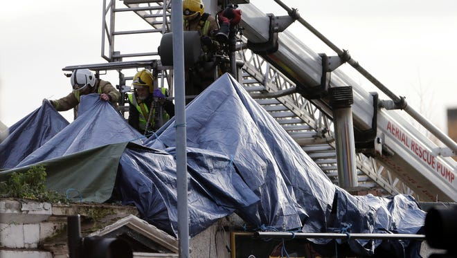 Scottish emergency workers work the scene Nov. 30, 2013, after a helicopter crashed into the Clutha Bar in Glasgow, Scotland.