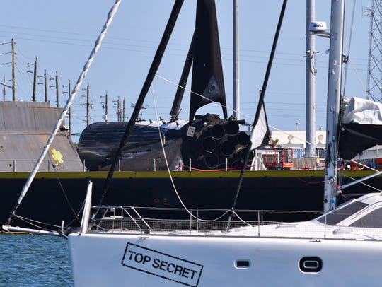 """A sailboat named """"Top Secret"""" travels past SpaceX's"""