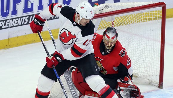 New Jersey Devils Brian Boyle (11) attempts to screen
