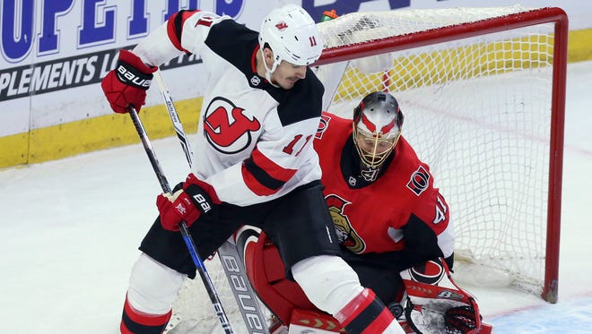 New Jersey Devils Brian Boyle (11) attempts to screen Ottawa Senators goaltender Craig Anderson (41) during the second period of an NHL hockey game Tuesday, Feb. 6, 2018, in Ottawa, Ontario.