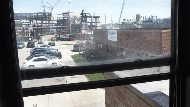 Looking through the window of the older of two buildings that make up Mariners Inn, overlooking the newer building and construction of the new Red Wings arena. Mariners Inn is a 24 hour, residential, substance abuse treatment facility for adult, homeless men of southeastern Michigan