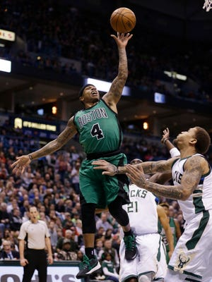 Boston's Isiah Thomas shoots over Michael Beasley during the second half Saturday.