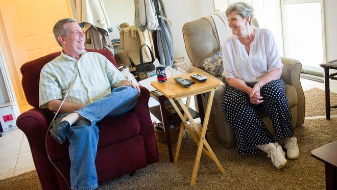John and Carole Morton, of Evansville joke around in their living room in Evansville, Thursday, Aug. 25, 2016. Both Carole and John have been living with alpha-1 antitrypsin deficiency, a genetic disorder that can lead to lung and liver diseases.