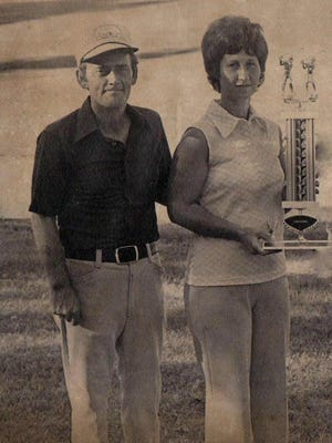 Larry and Jean Monson with the trophy after winning the Husband-Wife Tournament at the Humboldt Country Club in 1974. They shot a 78 for 18 holes and a three-shot victory.
