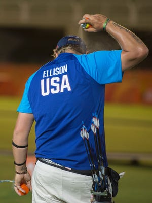 Brady Ellison of the U.S. archery team sprays himself with mosquito spray during practice at the Sambodromo stadium ahead of the 2016 Rio Olympic Games in Rio de Janeiro on Aug. 3.