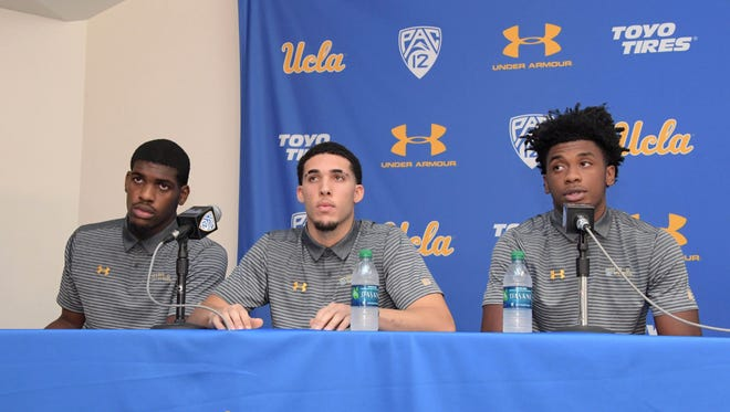 From left to right, UCLA's Jalen Hill, LiAngelo Ball and Cody Riley read statements at a news conference Nov. 15 in Los Angeles regarding arrest of the freshman players in China for shoplifting.