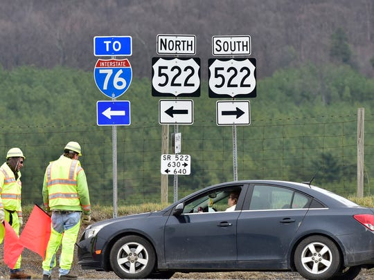 PennDOT workers closed Pa. 522 North at Pa. 475 near Fort Littleton and detoured traffic Sunday, March 20, 2016. Authorities say three people are dead following what appears to have been a robbery attempt on the Pennsylvania Turnpike in the vicinity of the Fort Littleton exit in Fulton County.