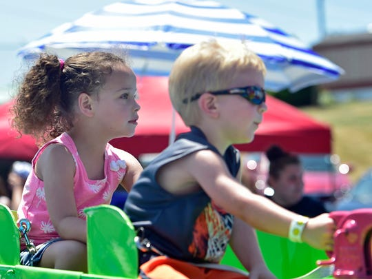 Aaliyah FLanders and Dylan Hall share a ride on the boat carnival ride on Wednesday, July 27, 2016. Shippensburg Community Fair is being held all week at the fairgrounds off Possum Hollow Road.