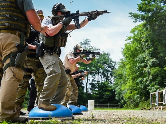 Officers shoot off of  balance balls as they participates in a drill as 28 police officers from 15 law enforcement agencies across Pennsylvania participated in a three day patrol rifle class taught by The Safariland Training Group on Wednesday, July 12, 2017. The class was hosted by Cleona Borough and North Cornwall Township police departments at the Lebanon County Police Combat Pistol Club.