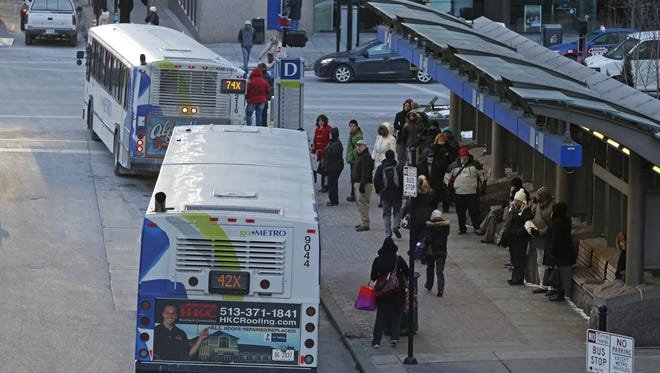 Passengers board buses at Walnut Street at Fifth Street in Downtown. Bus transportation is the only form of mass transit in Greater Cincinnati.
