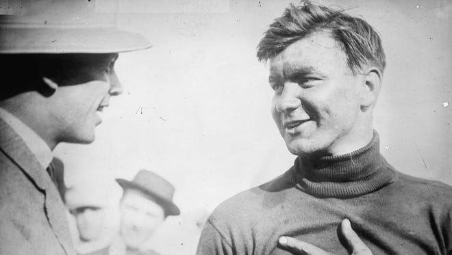 Joe Dawson, right, following his victory in the 1912 Indianapolis 500.  This photo appeared in The Indianapolis News on May 31, 1912.