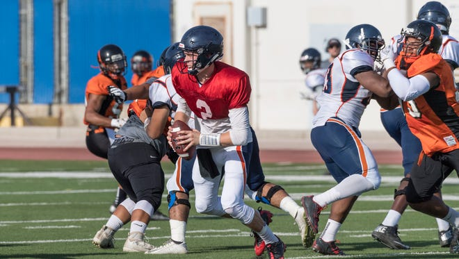 College of the Sequoias Quarterback Ryan Johnson plays against Reedley College in a scrimmage on Tuesday, August 21, 2018.