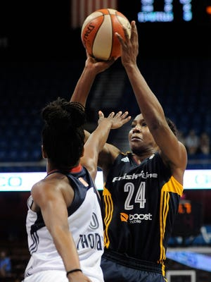 Indiana Fever's Tamika Catchings shoots the game-winning basket as Connecticut Sun's Jasmine Thomas defends during overtime of a WNBA game, Tuesday, July 28, 2015, in Uncasville, Conn. Indiana won 75-73.