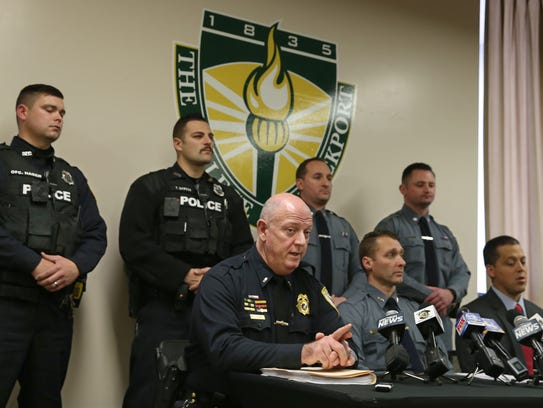 Brockport Police Chief Mark Cuzzopoli, front row left,