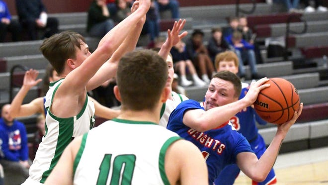 Peoria Heights' Jared Crew, right, meets a wall of defense from Wethersfield in the Class 1A Regional basketball tournament Tuesday  in Princeville.