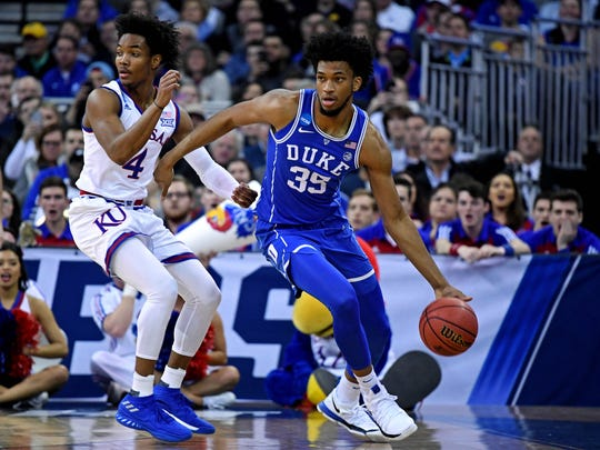 Duke Blue Devils forward Marvin Bagley III (35) handles the ball against Kansas Jayhawks guard Devonte' Graham (4) during the first half in the semifinals of the Midwest regional of the 2018 NCAA Tournament at CenturyLink Center.