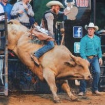 """Manfield bull rider Peter Bisel riding """"MO 40"""" at Buckin' Ohio in July 2015"""