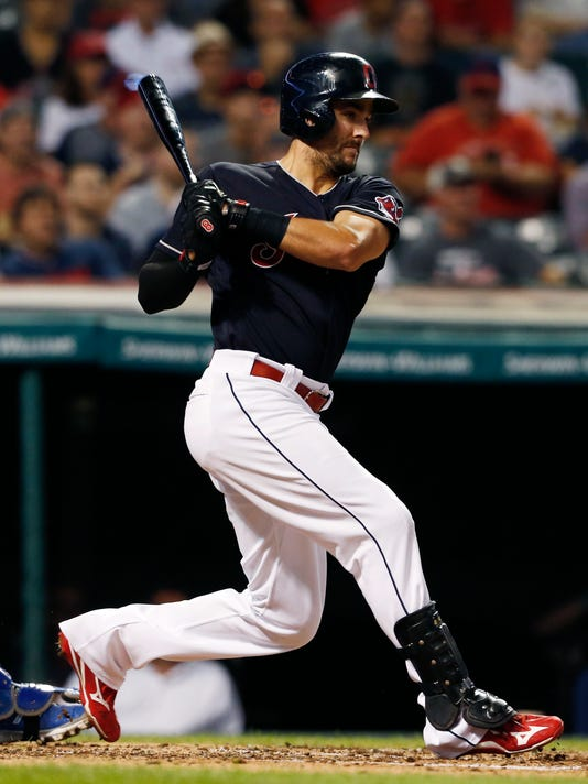 Cleveland Indians' Lonnie Chisenhall hits an RBI single off Kansas City Royals starting pitcher Ian Kennedy during the second inning of a baseball game Wednesday, Sept. 21, 2016, in Cleveland. (AP Photo/Ron Schwane)