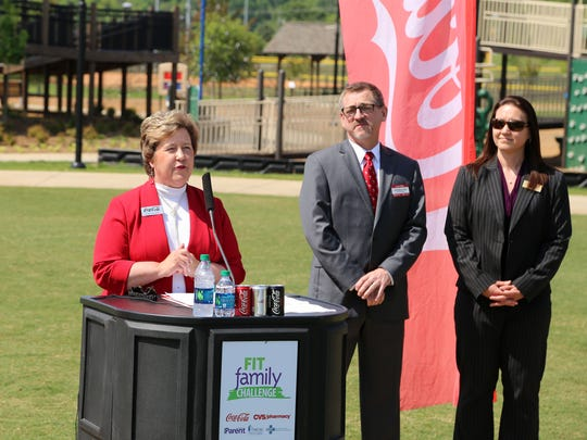 Alison Patient, senior director of coorporate affiars for Coca-Cola Bottling Co., speaks during a press conference to kickoff the Fit Family Challenge.