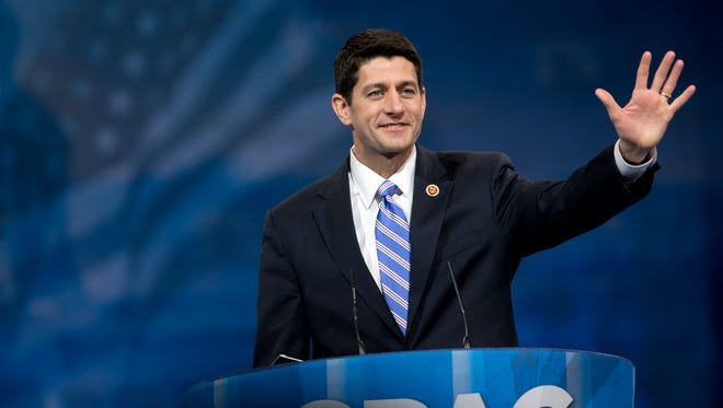 In this March 15, 2013, file photo, House Budget Committee Chairman, Rep. Paul Ryan, R-Wis. waves as he arrives before speaking at the 40th annual Conservative Political Action Conference in National Harbor, Md.