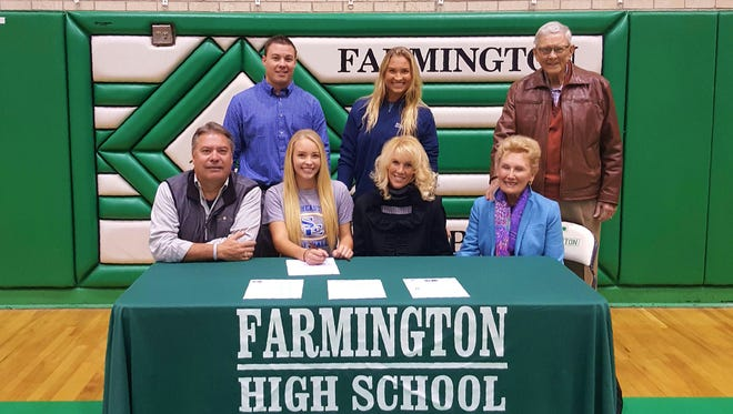Farmington's KK Blackwood signs a national letter of intent to play softball for Southeastern Oklahoma State University on Wednesday at Scorpion Gym in Farmington.