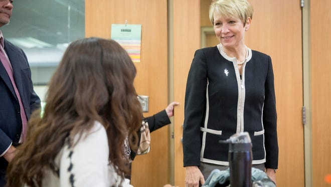 Former Lt. Gov. Sue Ellspermann, the new president of Ivy Tech Community College, talks with students during her tour of the John & Janice Fisher Building Monday afternoon. The new president was touring several of the local Ivy Tech campuses through the day.