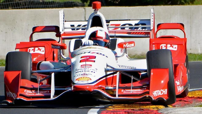 Juan Pablo Montoya uses all of the racetrack and then some in Turn 6 during an IndyCar Series test at Road America in Elkhart Lake on Sept. 22, 2015.