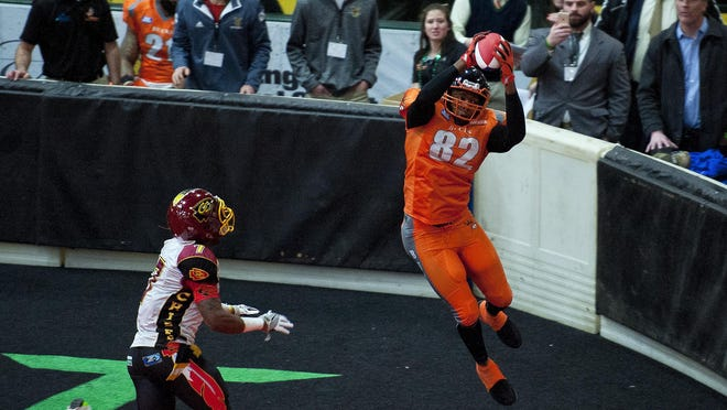 Vermont Bucks receiver Devon Mackey hauls in a touchdown catch against the Connecticut Chiefs during Friday night's game.