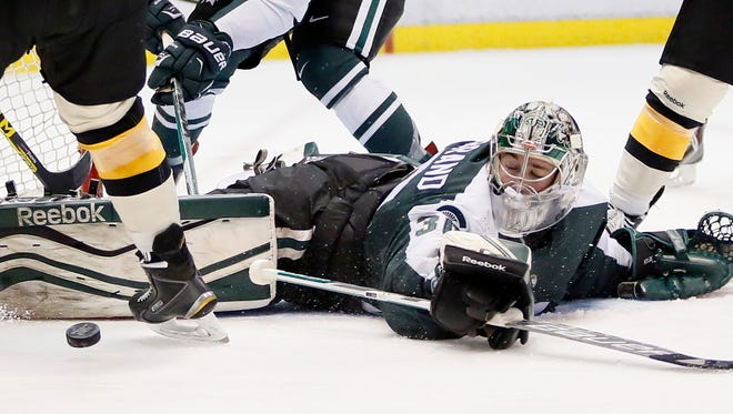 Michigan State's Jake Hildebrand makes a save against Michigan Tech during the second period of the Great Lakes Invitational college hockey game Tuesday, Dec. 29, 2015, in Detroit.