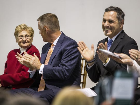 Marcy Aitken looks to her son Mark as she's applauded at a ceremony honoring Aitken for her contributions to Archmere on Thursday evening.