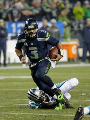 Seahawks quarterback Russell Wilson runs against the Carolina Panthers on Jan. 10 in Seattle.