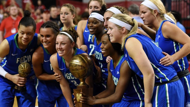 FGCU players pose after losing the WNIT championship to South Dakota at the DakotaDome in Vermillion, S.D., Saturday, April 2, 2016.