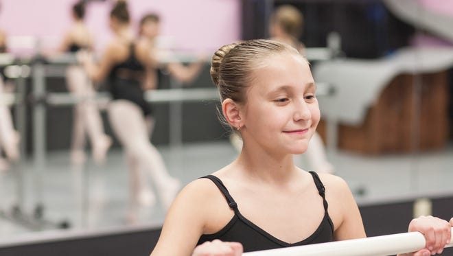 West Chester Academy student Samantha Rajauskas practices dance in the old facility.