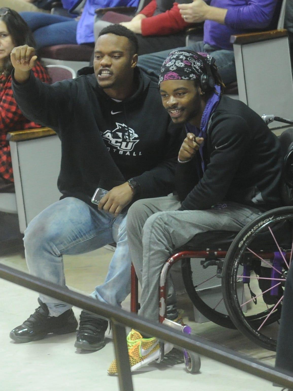 ACU football player Melvin Brown, left, and J.R. Hall