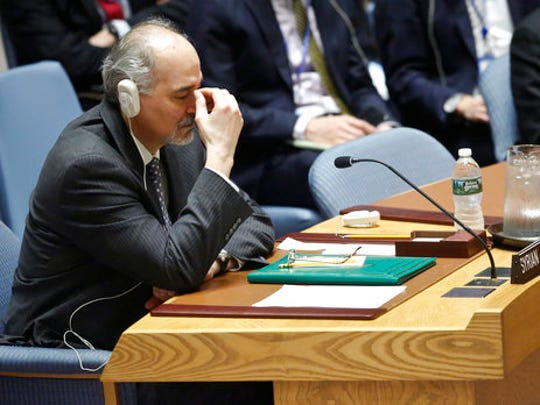 Syria's Ambassador to the United Nations Bashar Ja'afari listens to speakers after a Security Council resolution vote condemning Syria's use of chemical weapons failed to pass, Wednesday, April 12, 2017 at U.N. headquarters.